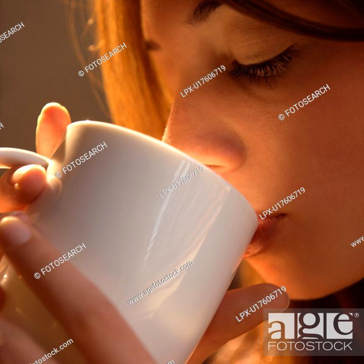 Stock Photo: Woman drinking from cup.
