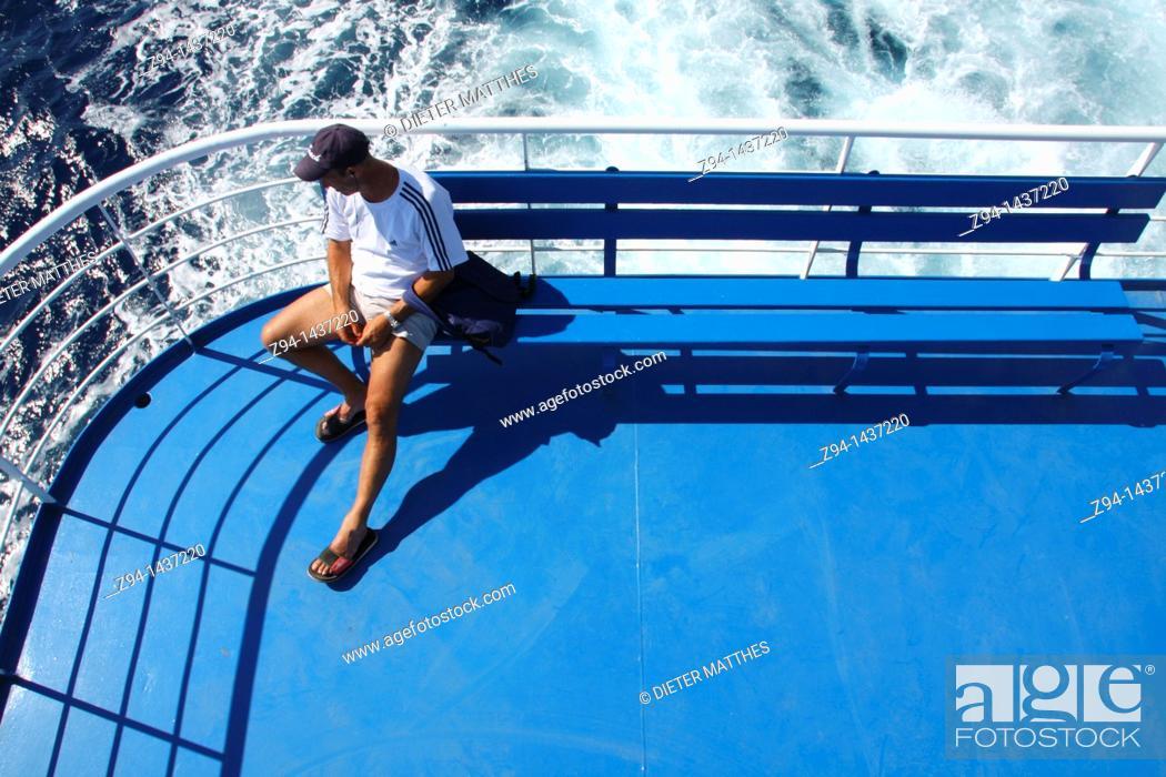 Stock Photo: Man on ship deck.