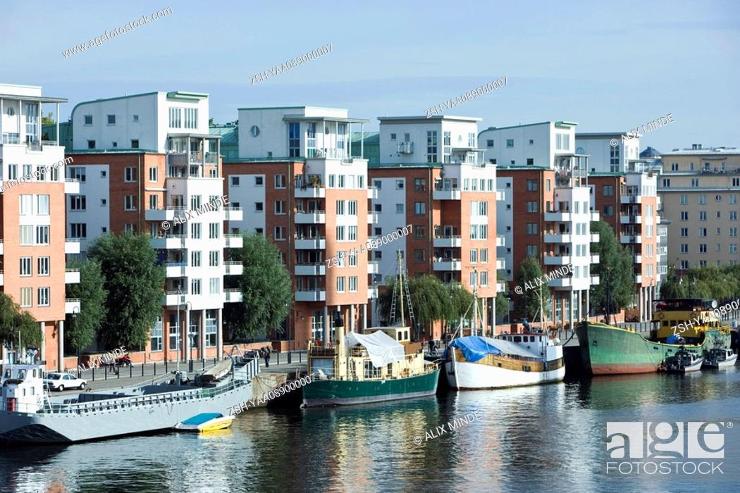 Stock Photo: Sweden, Sodermanland, Stockholm, waterfront apartment buildings.