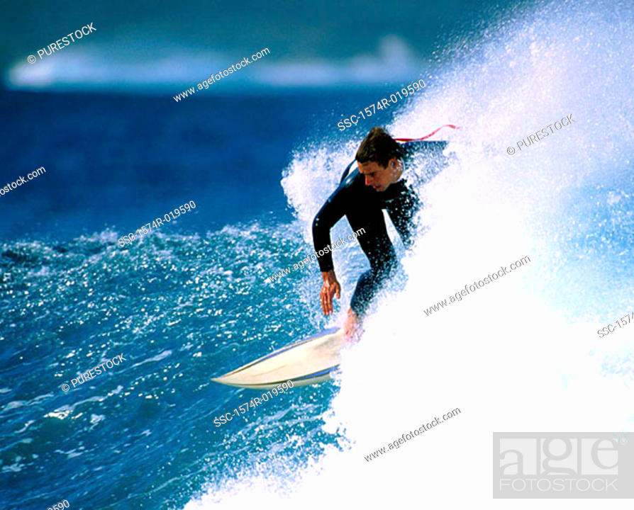 Stock Photo: Mid adult man surfing in the sea.