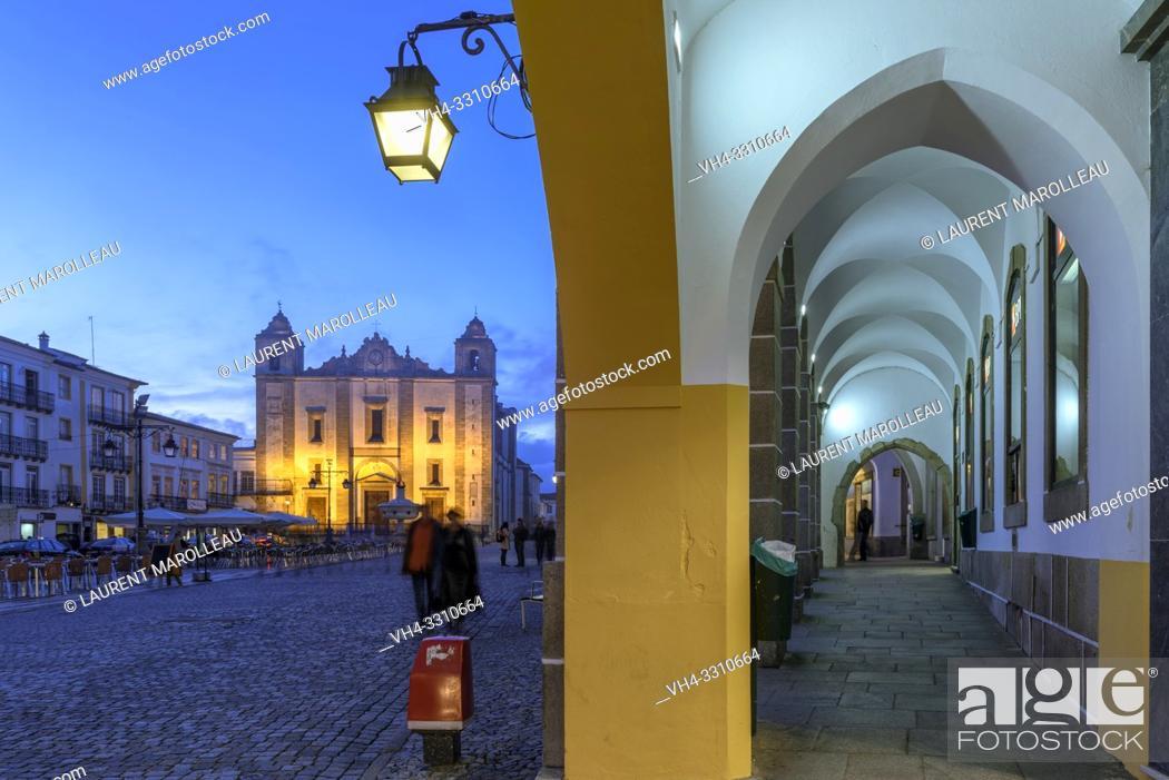 Stock Photo: Arcade and Church of Santo Antao at Giraldo Square at Dusk, Evora, Alentejo Region, Portugal, Europe.