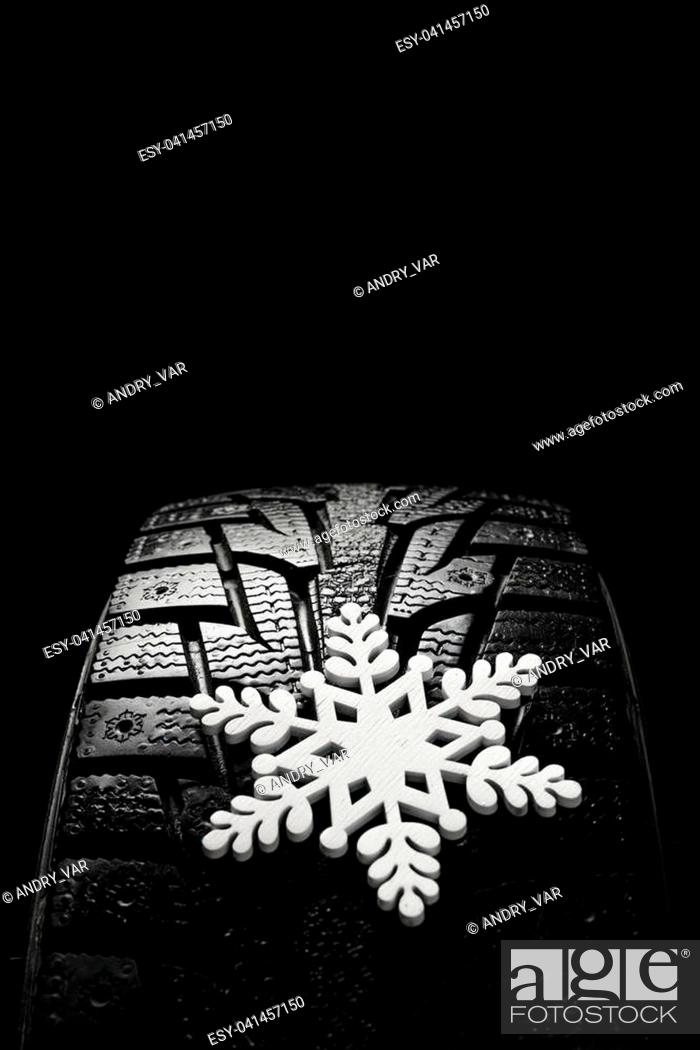 Stock Photo: Winter tires. Tires for winter with snow on a black background.