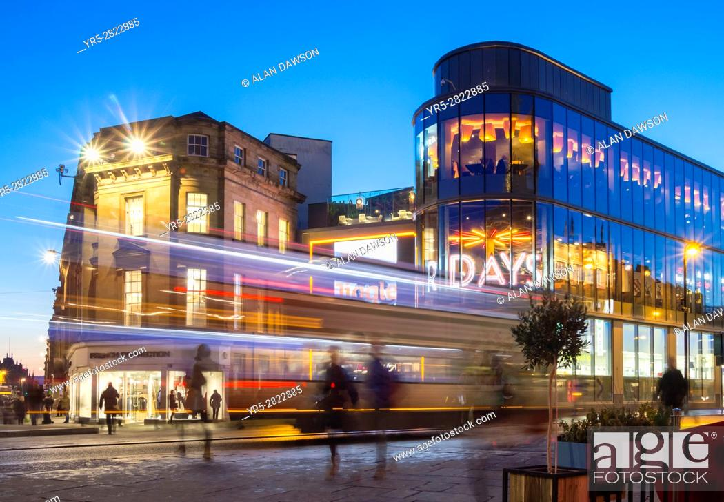 Stock Photo: Newcastle upon Tyne, England, United Kingdom. Bus passing entrance to Eldon square shopping centre in Newcastle city centre.