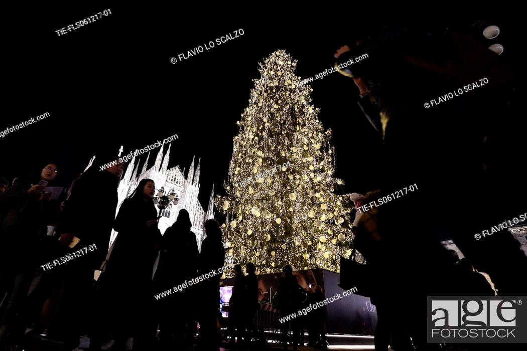 Stock Photo: People attend the Christmas tree lighting ceremony at Duomo's square in Milan -ITALY-06-12-2017.