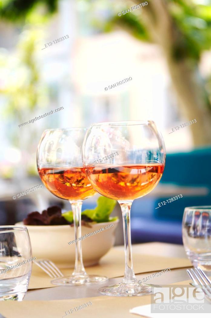 Stock Photo: Glasses of rosé (Bandol AOC) on the table of a restaurant, La Cadière-d'Azur, Var, Provence-Alpes-Côte d'Azur, France.