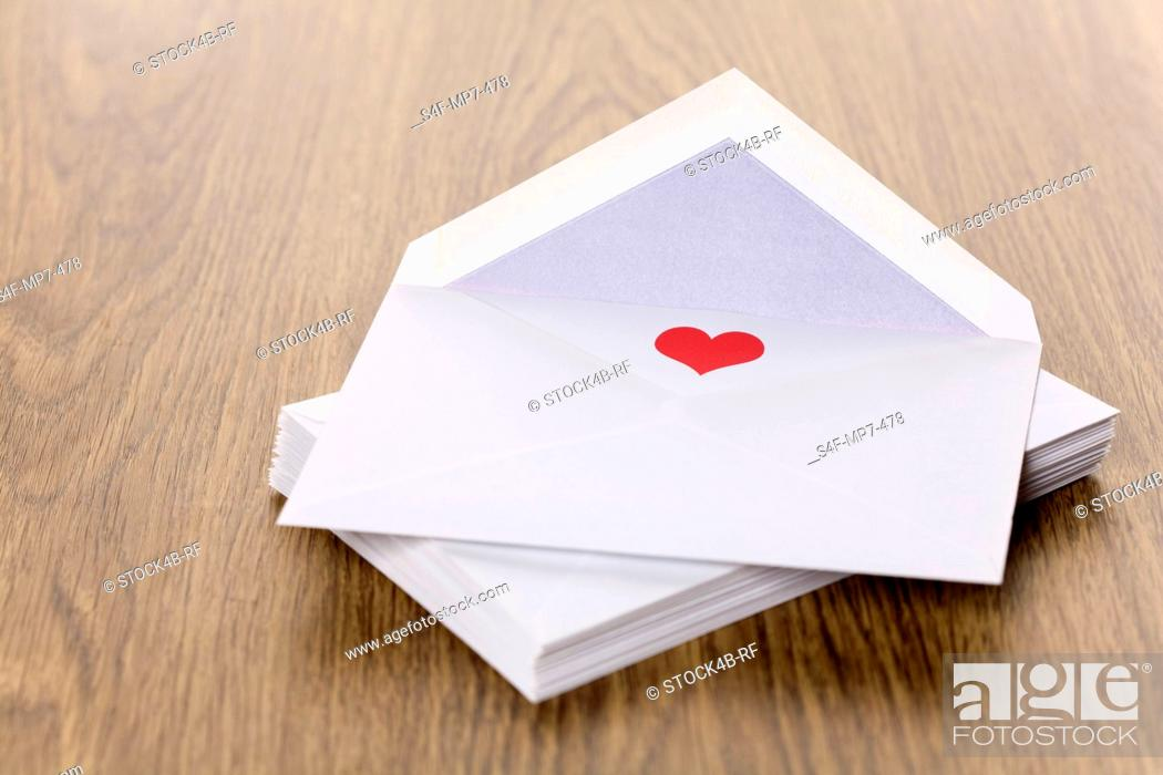 Stock Photo: Red heart in an envelope.