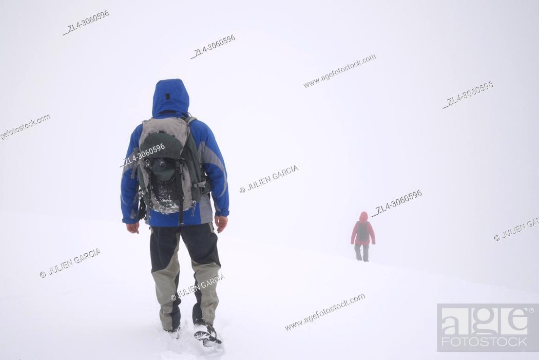 Stock Photo: Norway, Oppland, Vaga, Jotunheimen National Park, trekkers at the summit of Glittertinden (Glittertind), the second highest mountain in Norway at 2465m above.