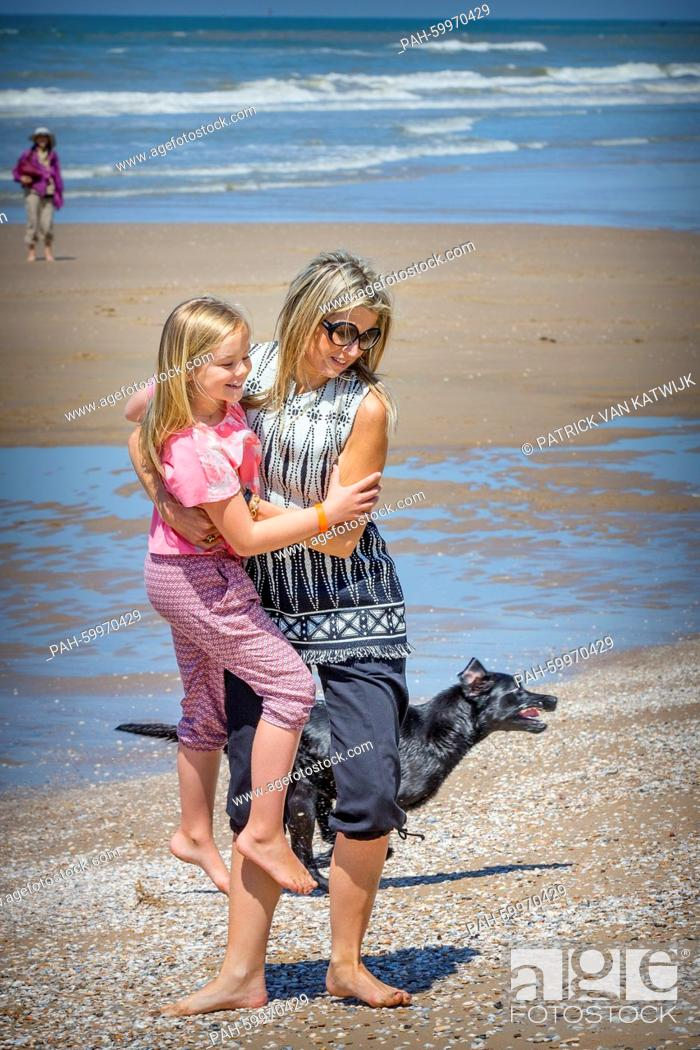 Stock Photo: Queen Maxima and her her daughter Princess Ariane of The Netherlands pose for the media at the start of their summer holidays at the beach of Wassenaar.