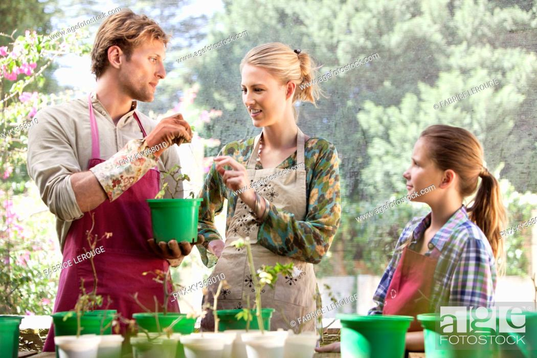 Stock Photo: Parents and daughter gardening.