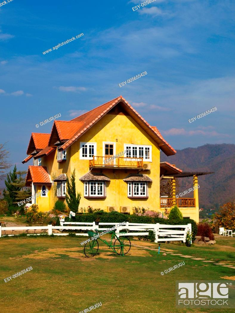 Stock Photo: Yellow lovely house and blue sky in pai, mae hong son, thailand.
