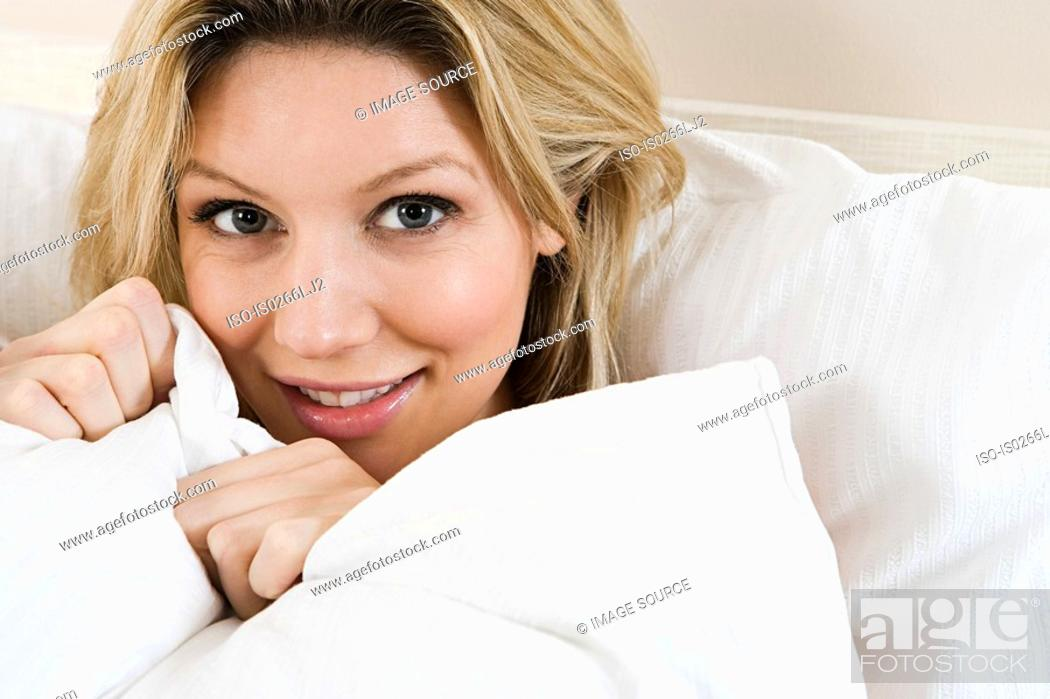 Stock Photo: Young woman in bed.