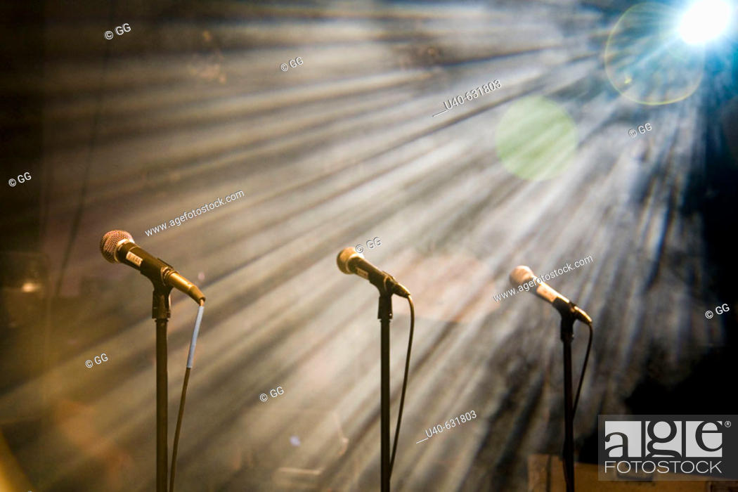 Stock Photo: Light streaming on microphones.