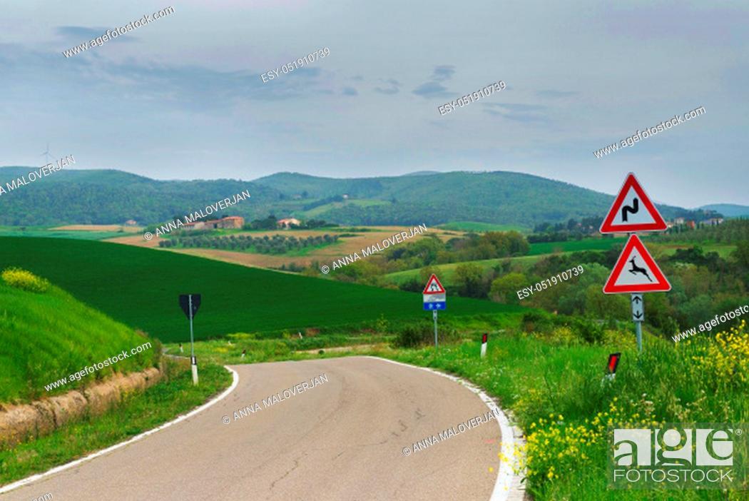 Stock Photo: Winding road in green hills Tuscany, Italy.