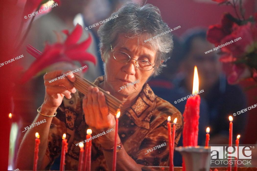 Stock Photo: Chinese New Year CapGoMeh Festival, People praying in the temple, Singkawang, Kalimantan, Indonesia, Borneo.