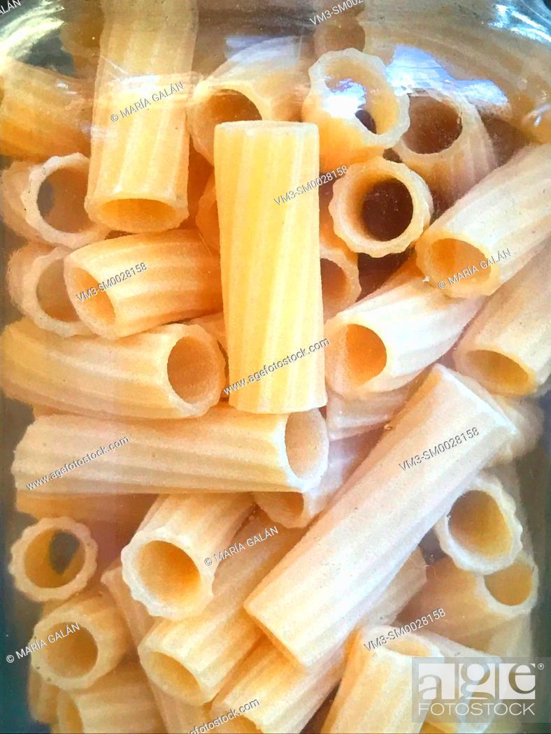 Stock Photo: Macaroni in glass jar.