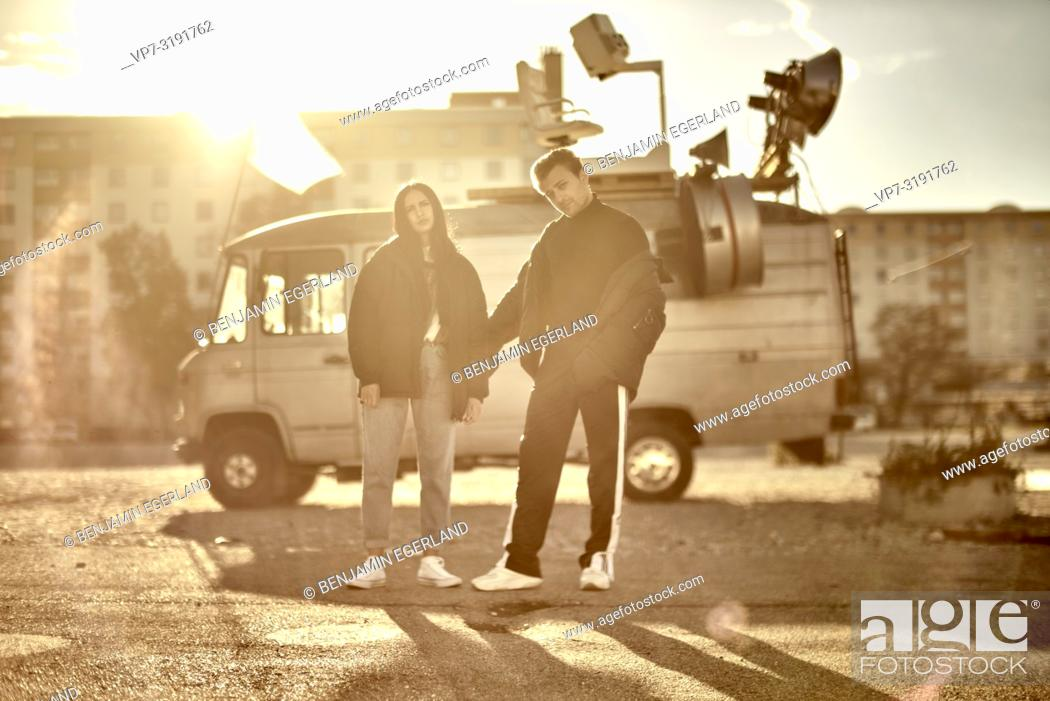 Stock Photo: couple in front of camper van, fashion Blogger Adem Bayalan and Emine Feruz Bayalan, in Munich, Germany.