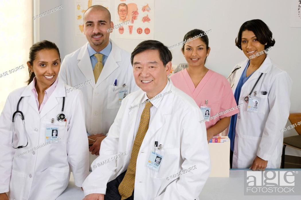 Stock Photo: Portrait of doctors and a nurse.