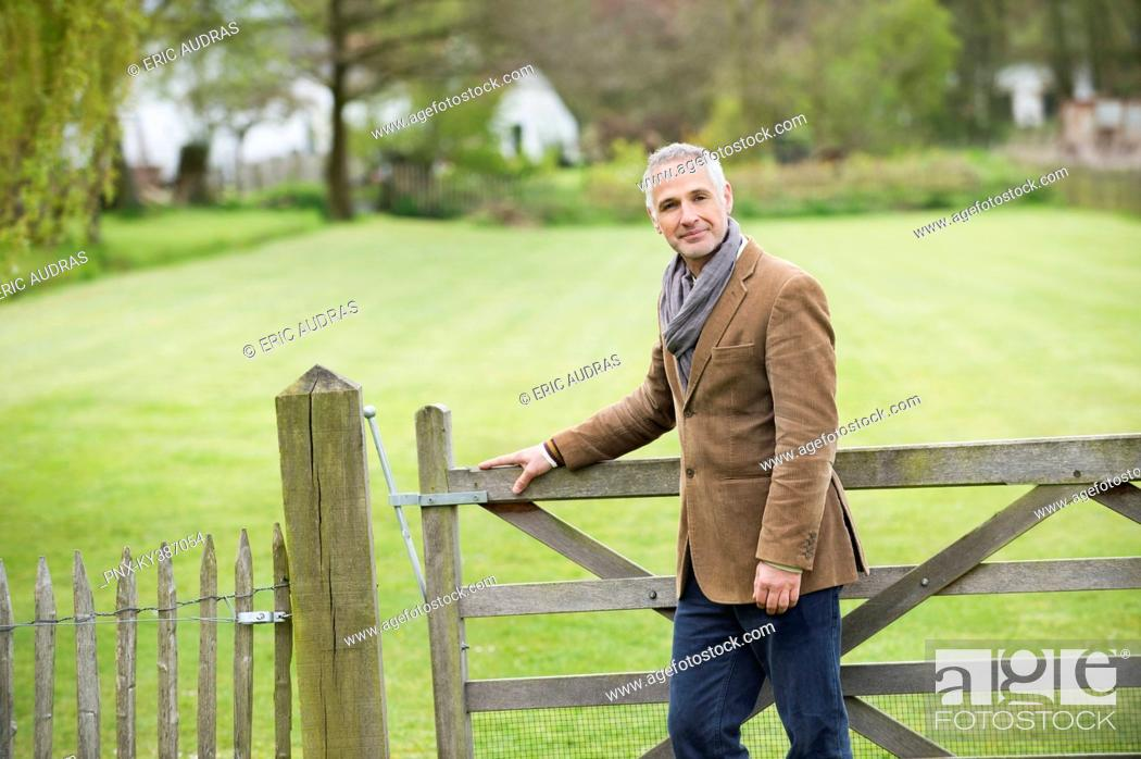 Stock Photo: Portrait of a man standing in a park.