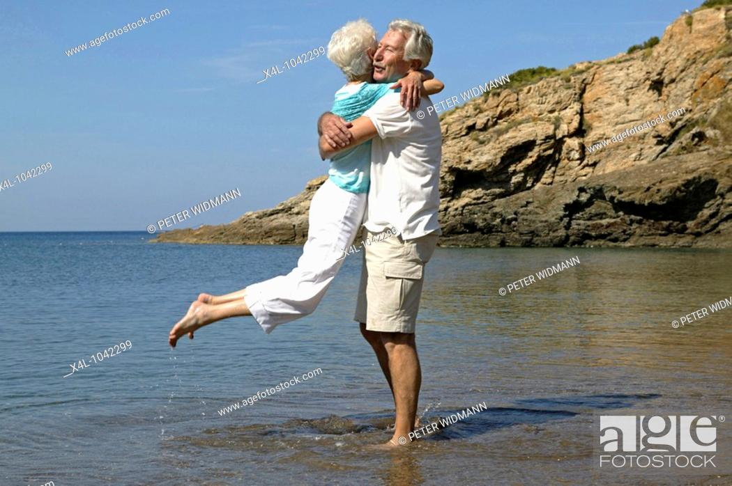 Stock Photo: happy senior couple having fun on summer holiday.