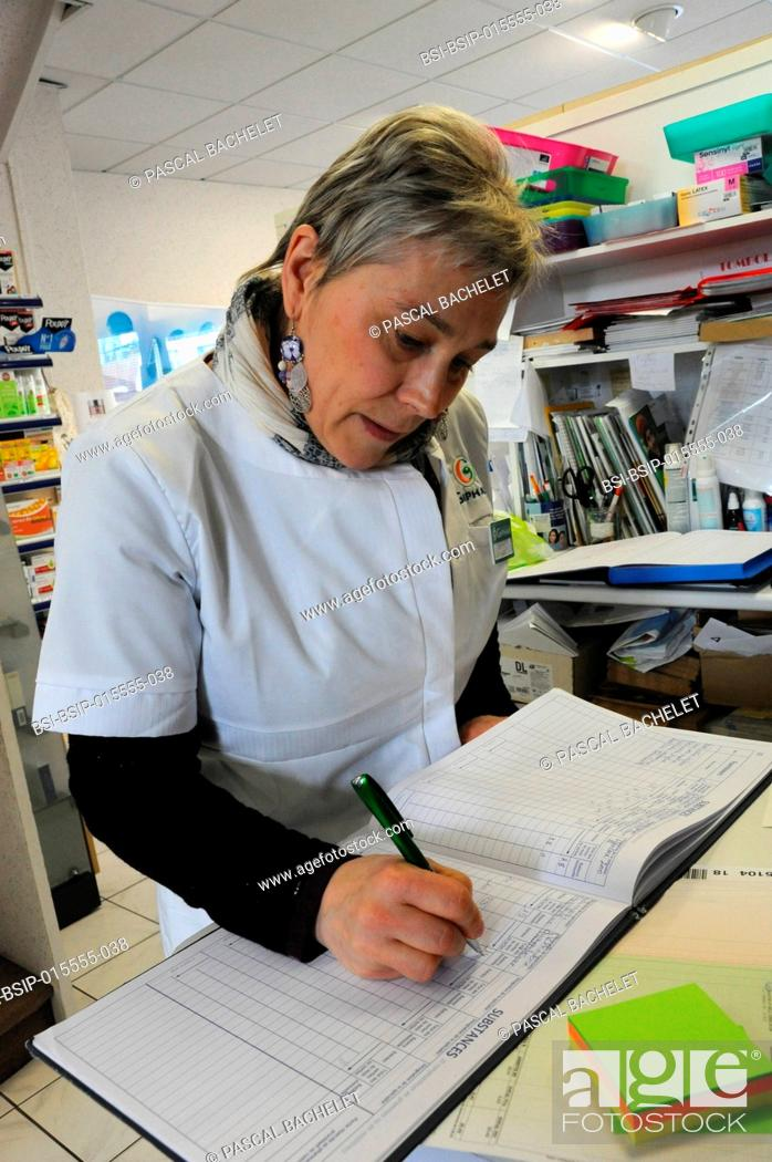 Stock Photo: Reportage in a pharmacy in Auxi-le-Château, France. Register of substances and medication classed as narcotics.