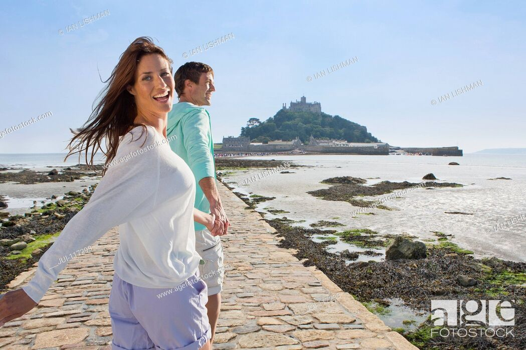 Stock Photo: Mature Couple Visiting St Michaels Mount In Cornwall.