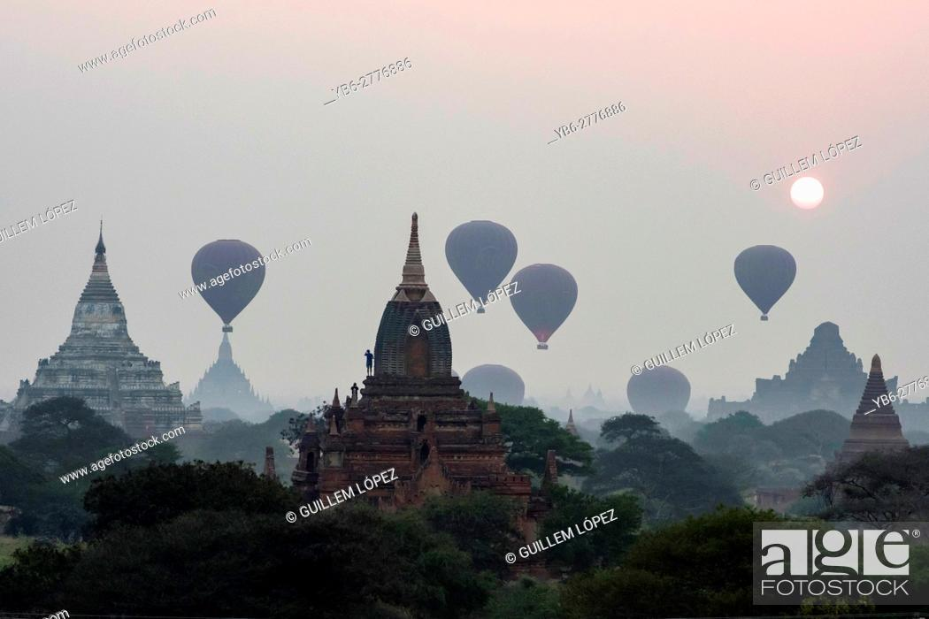 Stock Photo: Silhoutte of Hot air Balloons flying over the temples of Bagan Historical site, Myanmar.
