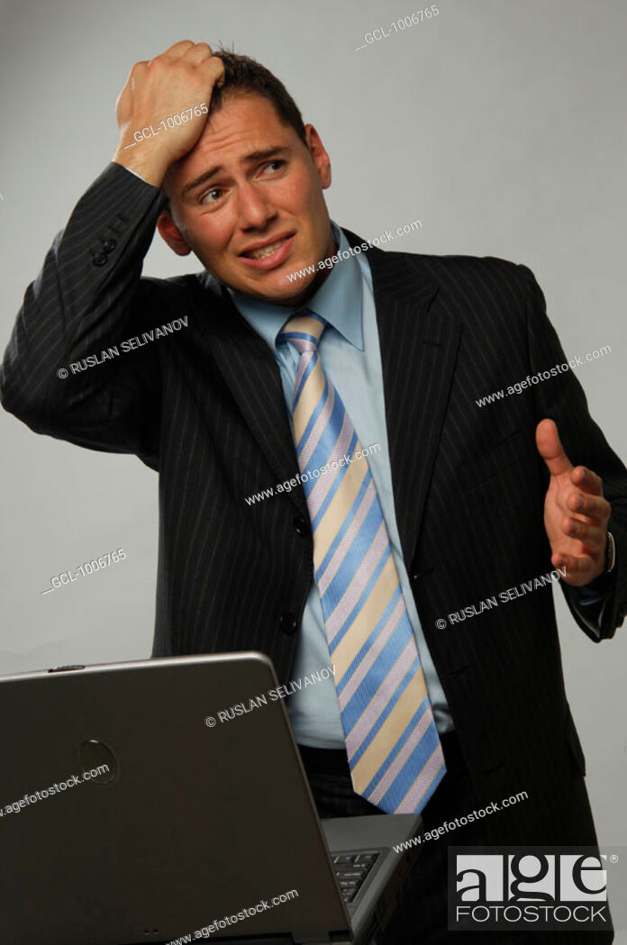 Stock Photo: Businessman tearing his hair in distress.