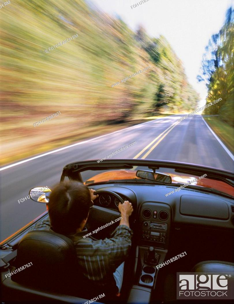 Stock Photo: car people man person driving sports down road.