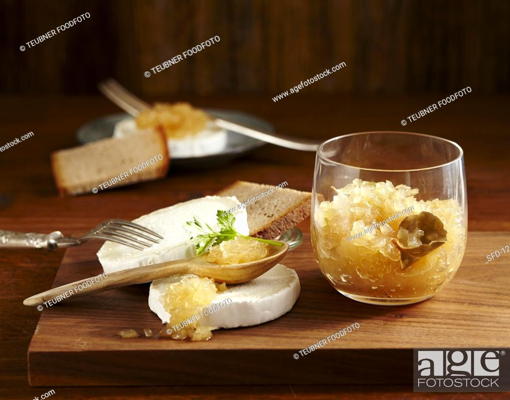 Stock Photo: Onion jam with bay leaves and white wine vinegar served with goat's cheese and bread.
