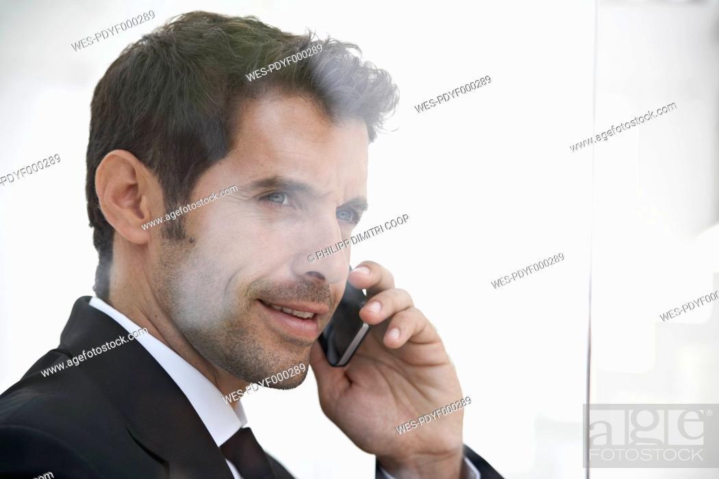 Stock Photo: Spain, Businessman talking on mobile phone.