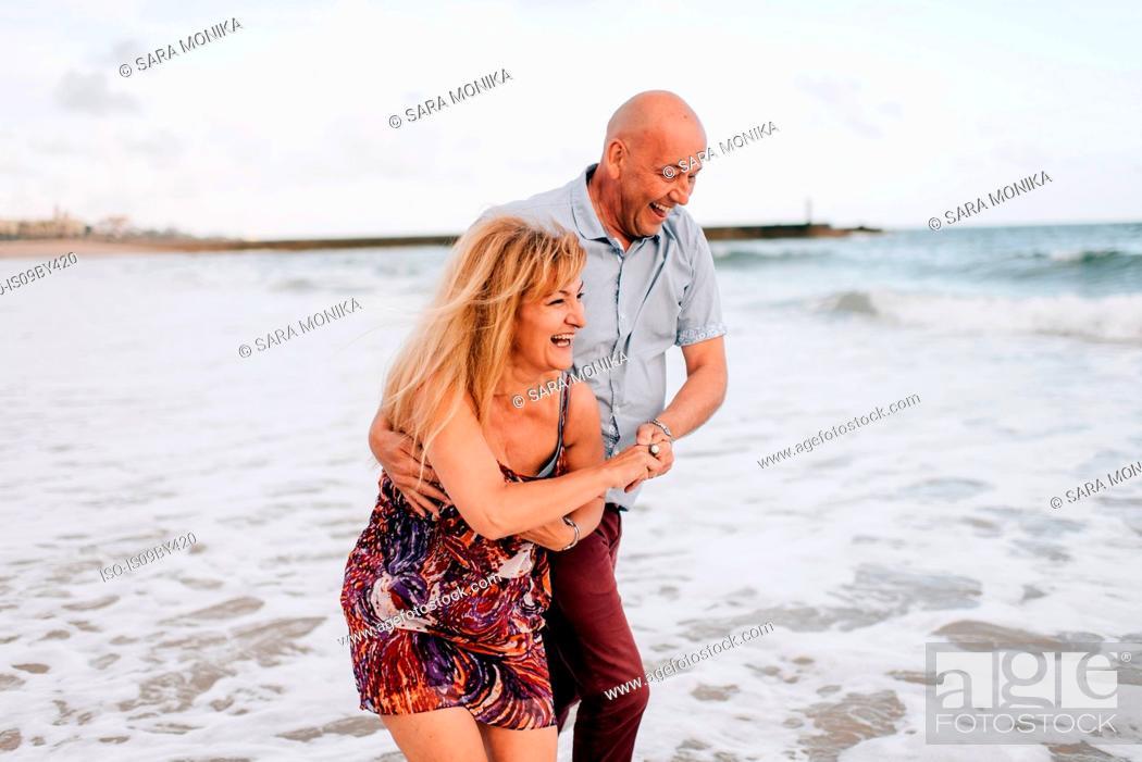 Stock Photo: Couple having fun on beach, Estoril, Lisboa, Portugal.