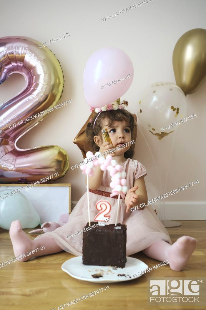 Stock Photo: A 2 year old girl celebrating her birthday.