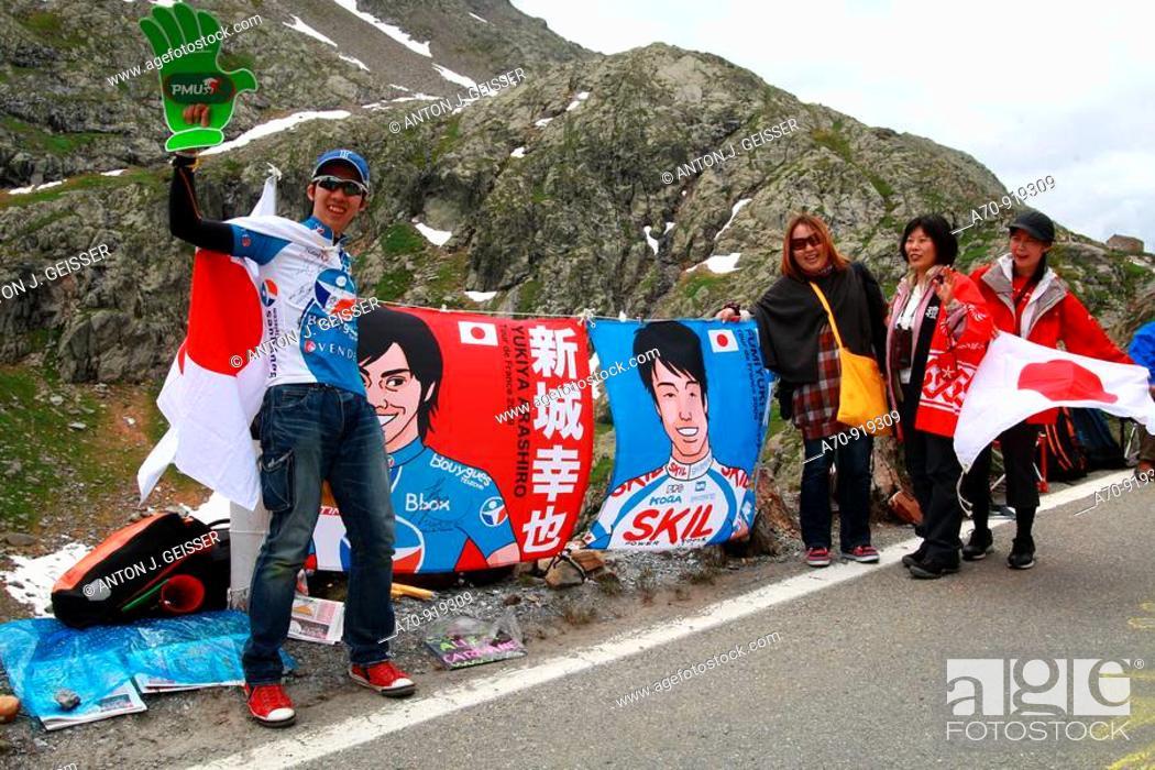 Stock Photo: Tour de France bicycle race, 16 stage Martigny-Bourg-Saint-Maurice: Japanese fans (July 21st 2009).