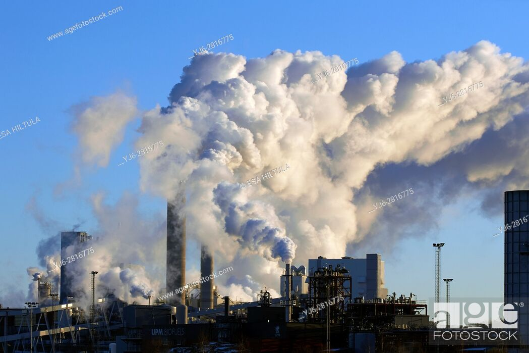 Stock Photo: Paper and pulp factory smokes on cold winter day, Lappeenranta Finland.