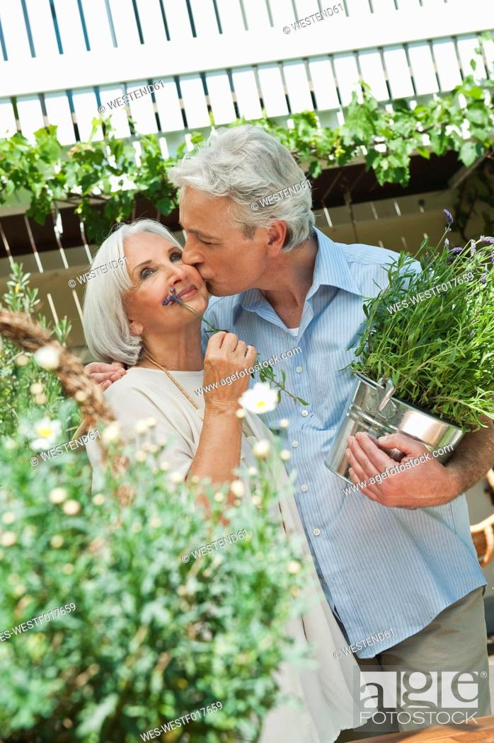 Stock Photo: Germany, Bavaria, Man and woman with potted plants.
