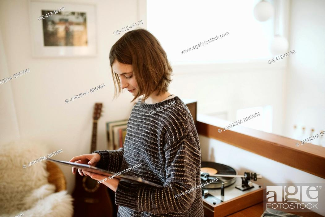 Stock Photo: Girl playing vinyl records.