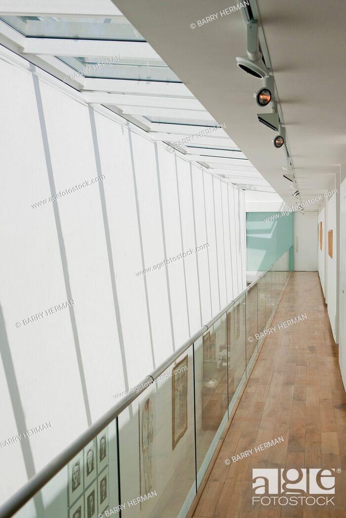 Stock Photo: Double height hallway and glass balustrade.
