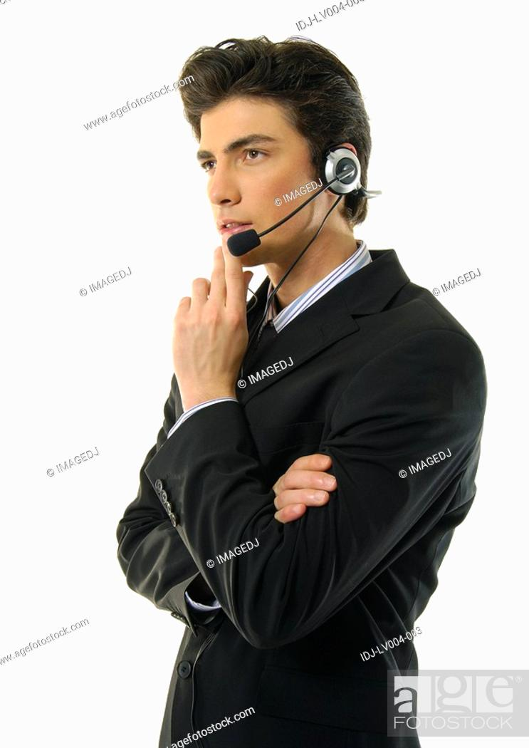 Stock Photo: Side profile of a businessman wearing a headset and thinking.