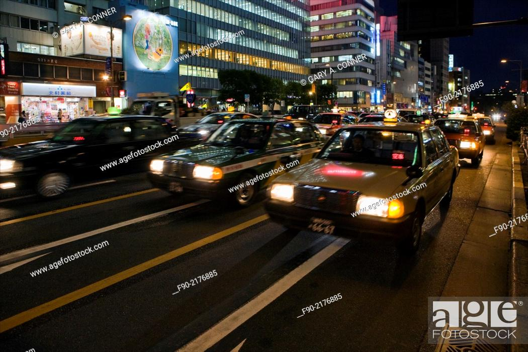 Stock Photo: Blur of taxis at dusk in Omotesando, Tokyo, Japan.