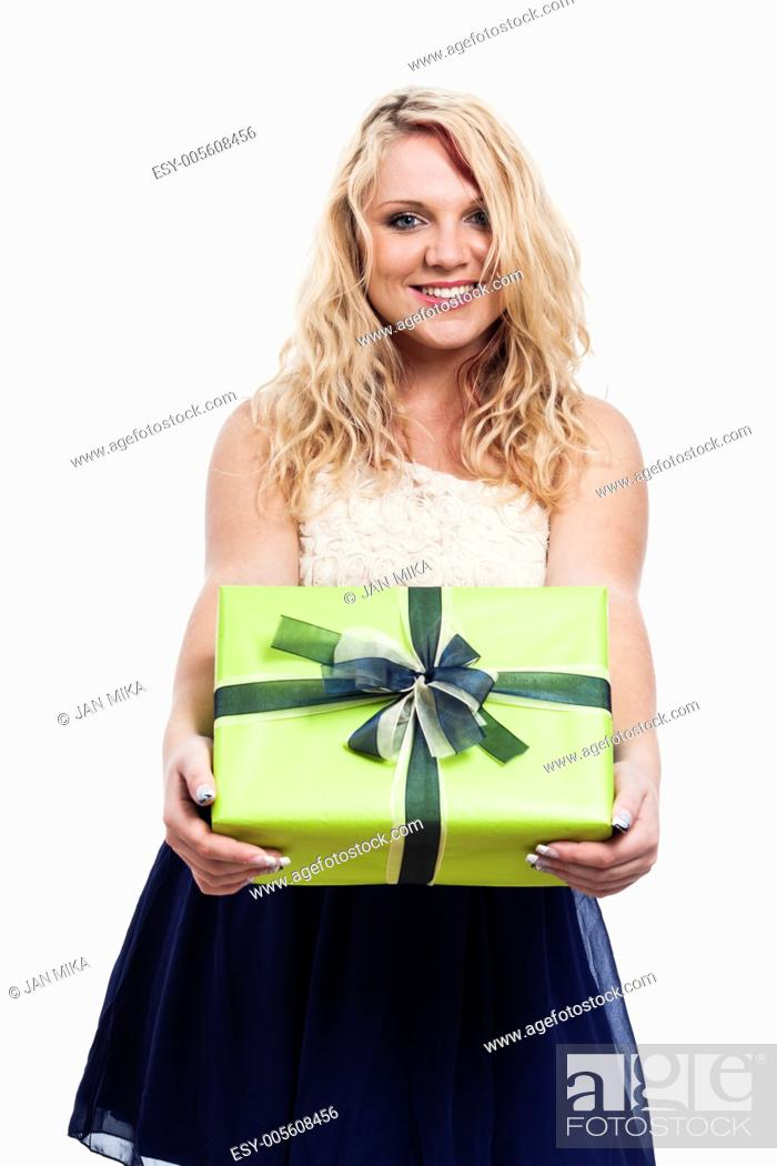 Stock Photo: Portrait of beautiful cheerful woman holding green gift box, isolated on white background.
