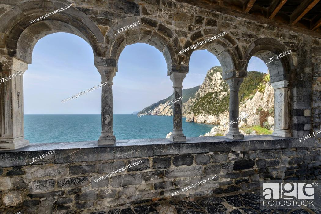 Stock Photo: breathtaking view of mediterranean coastline through the loggia mullions of St. Peter church, shot on a sunny spring day, Portovenere, Italy.