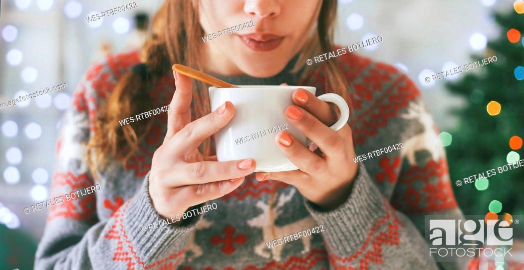 Stock Photo: Woman with cup of coffee at Christmas time, close-up.