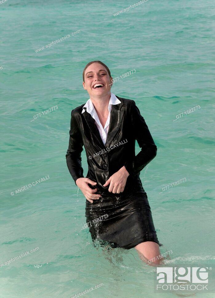 Stock Photo: Maldives Islands Ari Atoll Business woman in sea.