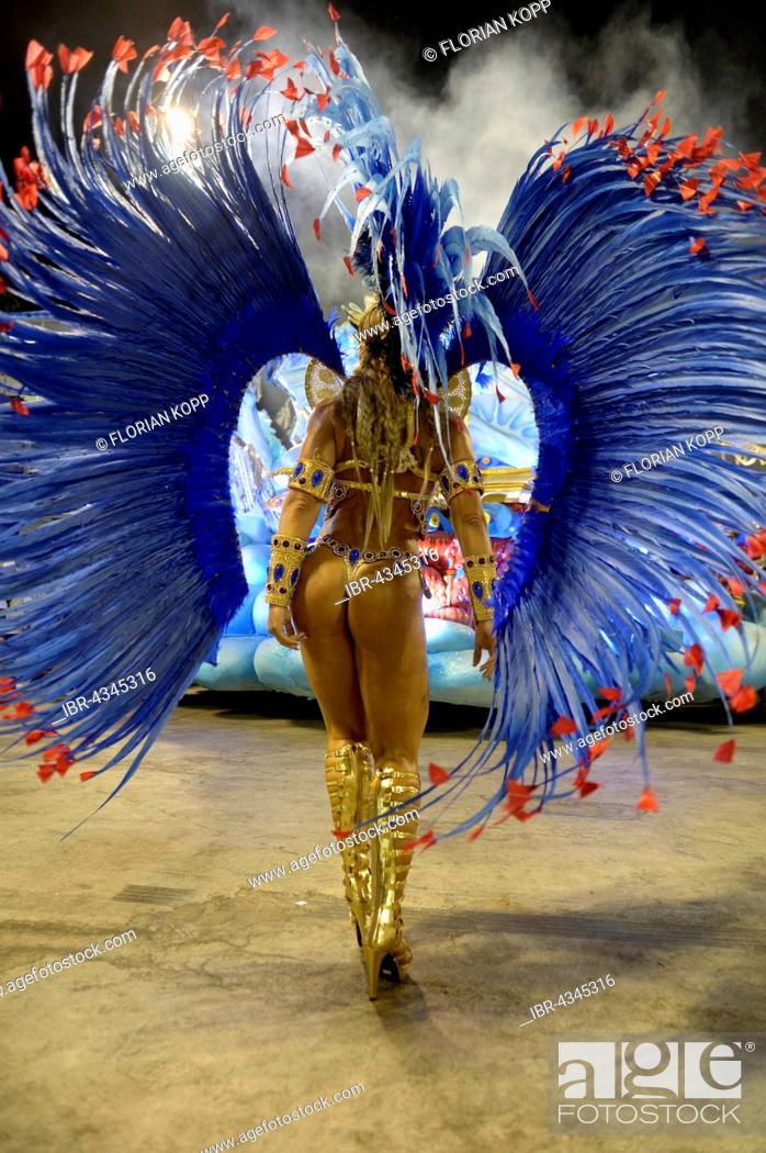 Samba dancer from behind, parade of the samba school Uniao