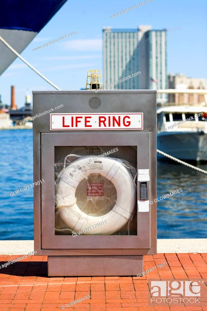 Stock Photo: Life belt at a dock, Inner Harbor, Baltimore, Maryland, USA.
