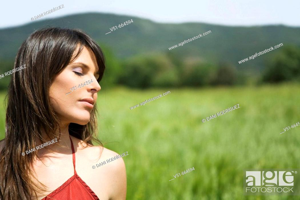 Stock Photo: Woman breathing fresh air.