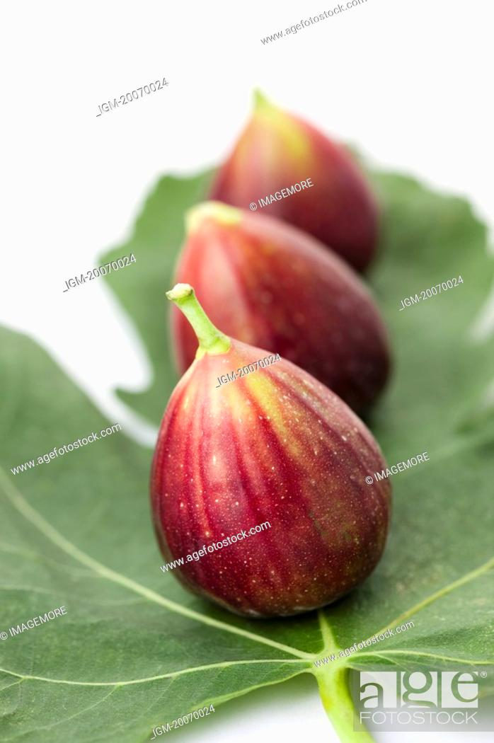 Stock Photo: Figs on a leaf.