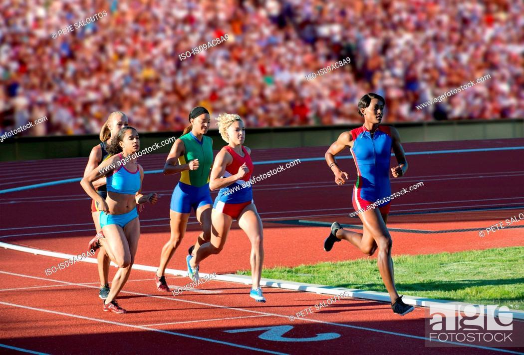 Stock Photo: Runners racing on track.