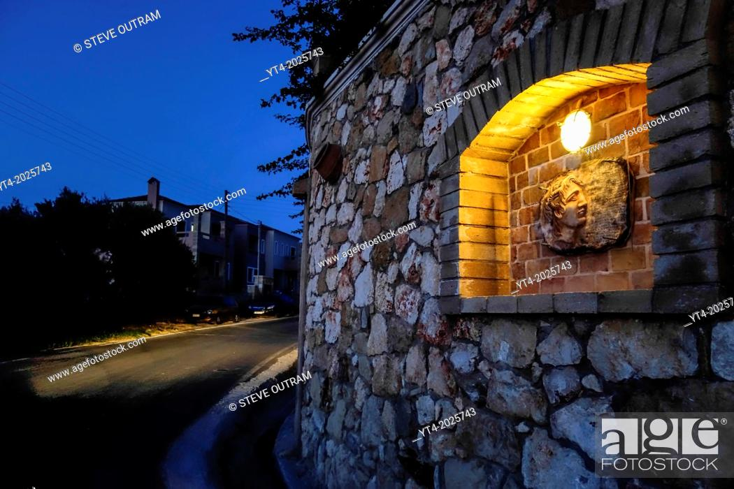 Stock Photo: Luxury Villa Wall in Crete Greece showing Stone Carving of Alexander The Great,.