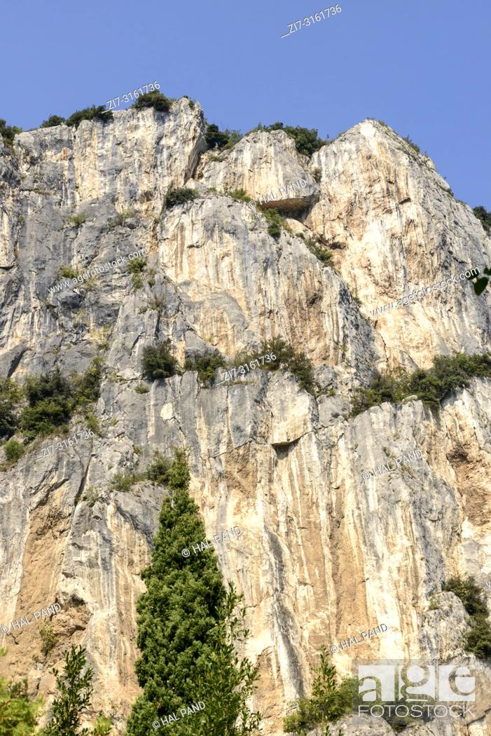 Stock Photo: landscape with overhanging cliffs , shot in bright fall light near Arco, Trento, Italy.